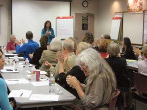 Susan facilitates a meeting