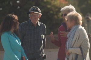 Susan listens to three senior citizens